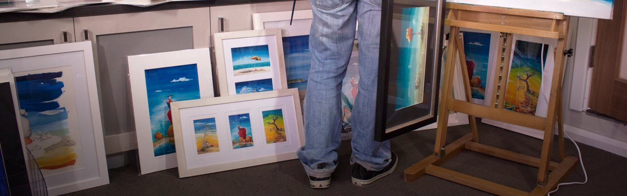 Perth artist Peter Ryan with prints in the studio